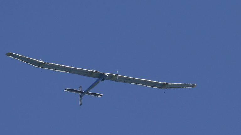 The Solar Impulse, piloted by Bertrand Piccard, flies over San Francisco Bay in April 2013. (AP Photo/Jeff Chiu)