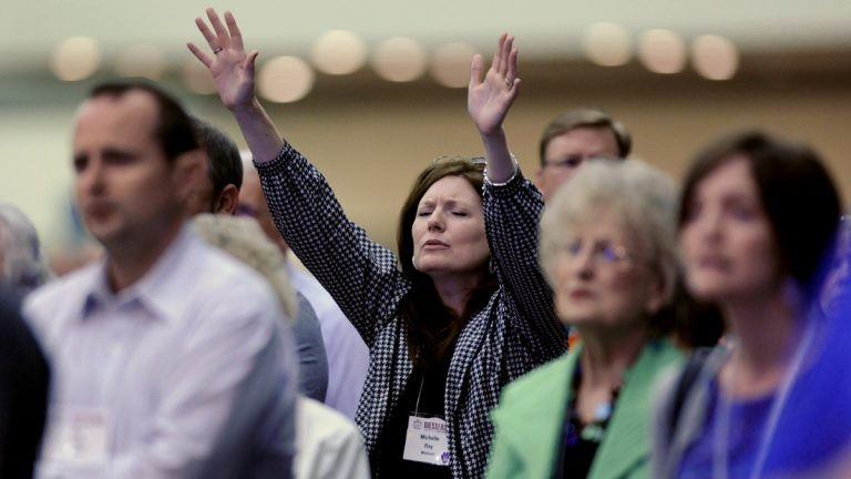 Michelle Ray, of West Plains, Mo., raises her hands in praise during the Southern Baptist Convention's annual meeting Tuesday, June 10, 2014, in Baltimore. The Southern Baptist Convention is the nation's largest Protestant denomination, with 15.7 million members, but leaders are concerned about recent membership declines. (AP Photo/Steve Ruark)