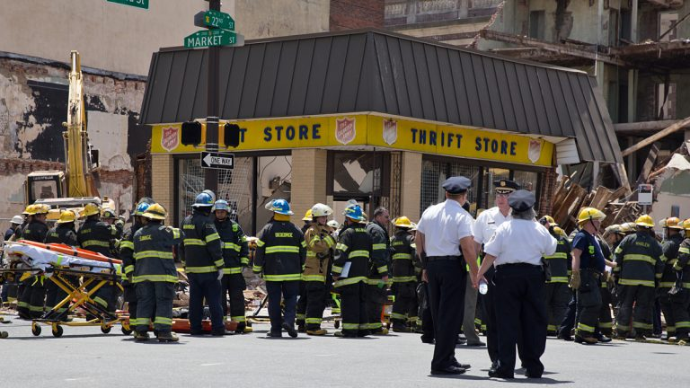 Philadelphia Fire Department personnel surround the Salvation Army Thrift Store at 22nd and Market streets in Center City on Wednesday, June 5, 2013. (Lindsay Lazarski/WHYY)