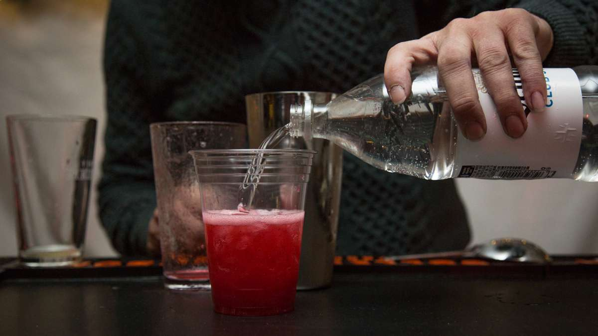 The night's signiture cocktail, a cranberry fizz, is poured at the beer garden inside The Franklin Square Holiday and Light Festival tent. The festival runs November 10 through December 31 and is free to the public.