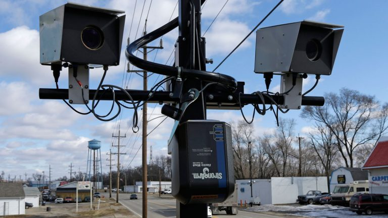 This Tuesday, Feb. 25, 2014 file photo shows speed cameras aimed at U.S. Route 127, in New Miami, Ohio. (AP Photo/Al Behrman, File)
