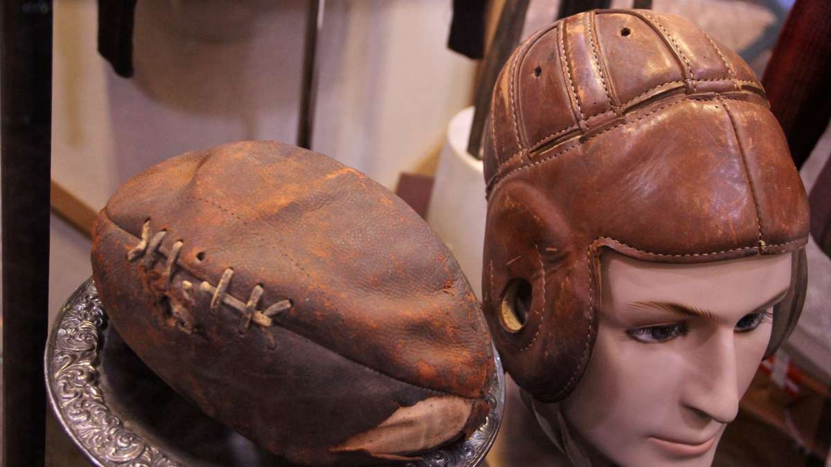 A helmet and football used by Jim Thorpe occupies a glass case in the center of the museum. (Emma Lee/WHYY)