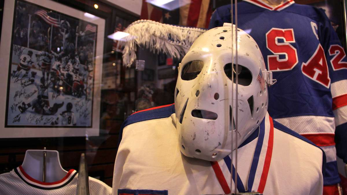 A section of the museum dedicated to olympic sports features mementos from the 1980 'Miracle on Ice' U.S.A hockey team, including the goalie mask worn by Jim Craig. (Emma Lee/WHYY)
