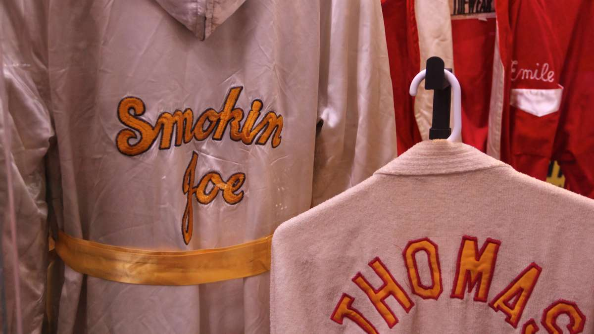 The collection includes robes worn by Philadelphia boxing great Joe Frasier. (Emma Lee/WHYY)
