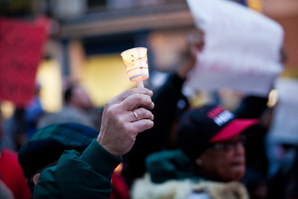 <p><p>A man holds a candle as he walks up Broad Street to the School Reform Commission meeting on Thursday. (Brad Larrison/for NewsWorks)</p></p>