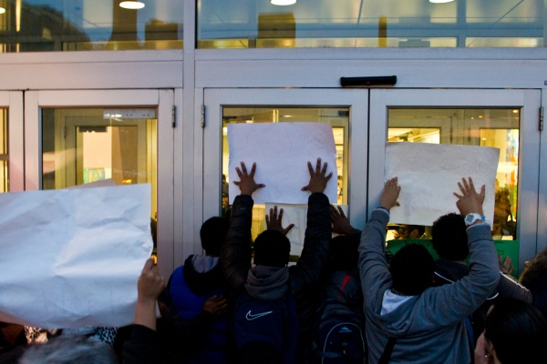 <p><p>Police did not immediately let students and parents into the Philadelphia School Districts headquarters Thursday night, leaving many uncertain of whether they would be able to sit in on the SRC meeting. (Brad Larrison/for NewsWorks)</p></p>