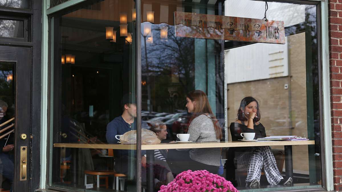 Natalie DeSisto, a junior from Pittsburgh, studies general science at Saint's Cafe on Beaver Avenue in downtown State College. (Lindsay Lazarski/WHYY)