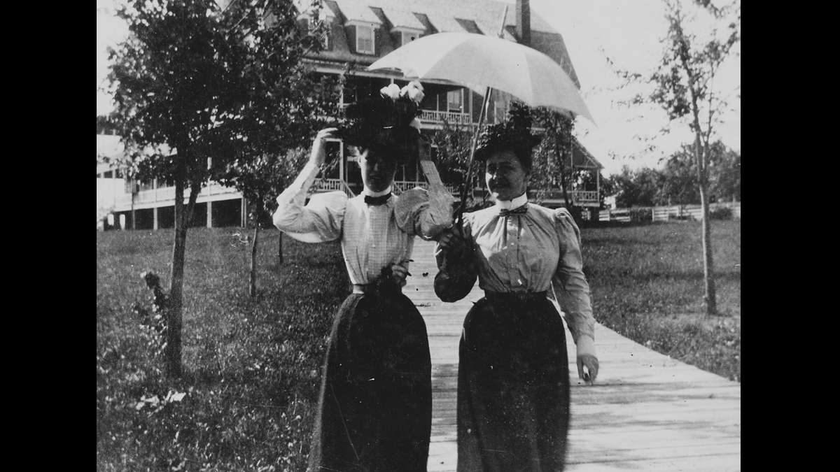 Miss Billy Cassin (left) and Clarea Tuttle walk near Penn State campus. (Image courtesy of the Centre County Historical Society)