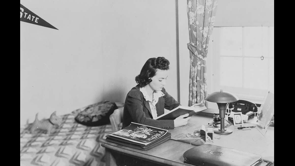 An unidentified woman studies at the Grange Memorial Dormitory for Girls — now known as the Grange Building. (Image courtesy of the Centre County Historical Society)