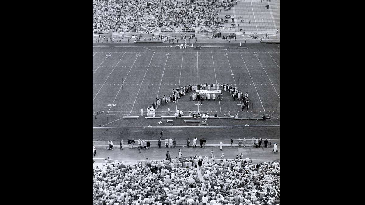 Fans watch a pre-game ceremony honoring the 1909 football team before the first game played at Beaver Stadium in 1960. (Image courtesy of the Centre County Historical Society)