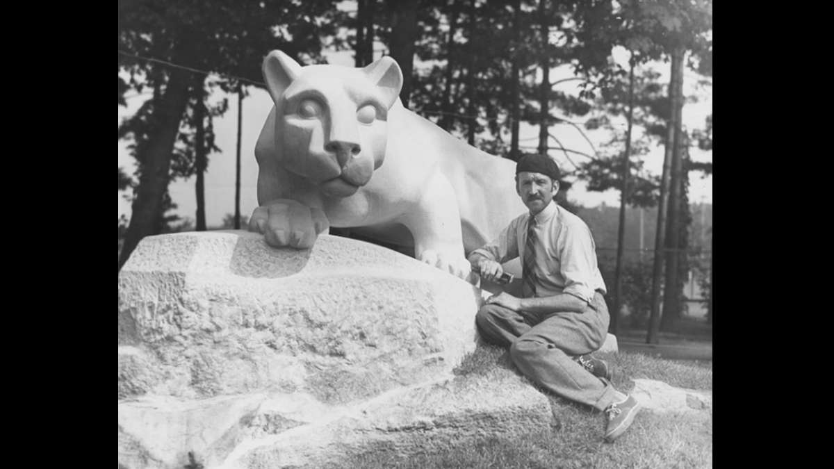 Sculptor Heinz Warneke at the base of the Nittany Lion Shrine. He created the sculpture out of Indiana limestone in 1942. The shrine was a gift from the class of 1940. (Image courtesy of the Penn State University Archives)