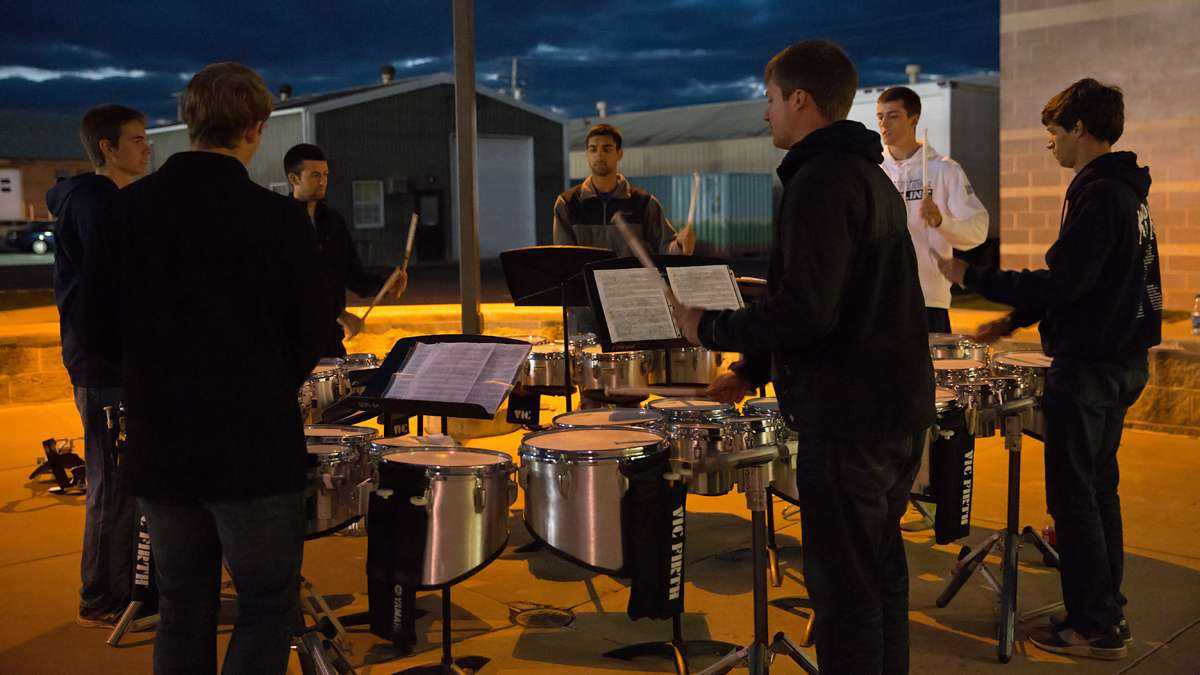 Members of the Penn State Blue Band percussion section rehearse before an upcoming home game. (Lindsay Lazarski/WHYY)