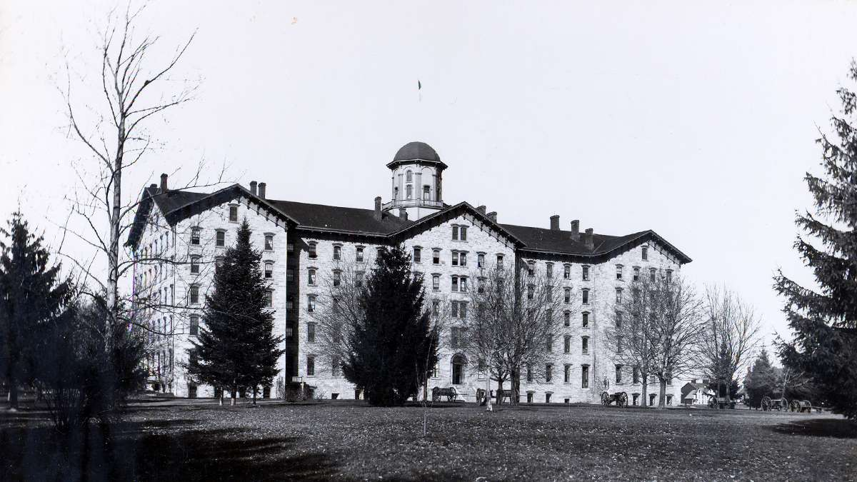 A view of the original Old Main known as 'Main Building' at Penn State circa 1863-1894. Made of limestone, the building was designed and constructed around the 1850's. (Image courtesy of the Centre County Historical Society)