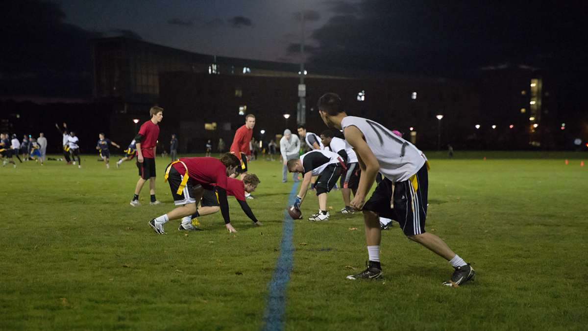A group of students play intramural flag football on a fall evening at Penn State University. (Lindsay Lazarski/WHYY)