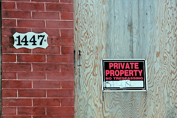 <p>Private property, but whose? Investigators say this boarded up row home on Bancroft Street was one of 22 city properties stolen by men who forged the deeds. (Emma Lee/for NewsWorks)</p>