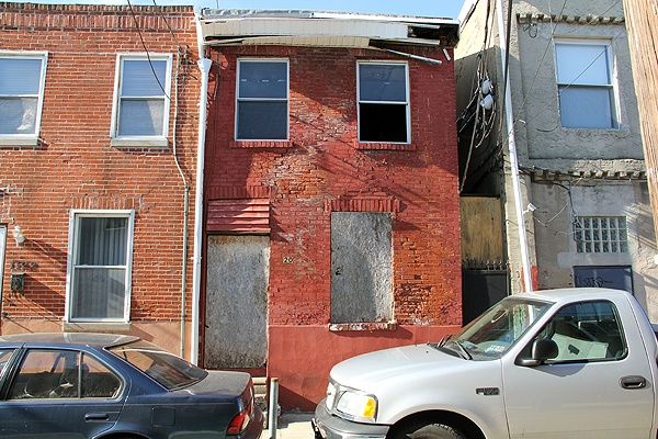 "<p>Investigators say this crumbling row home at 1120 Clifton Street was stolen by men who forged the deed. ""Why would you steal that,"" wondered a passing pedestrian. ""What would you do with it?""</p>"