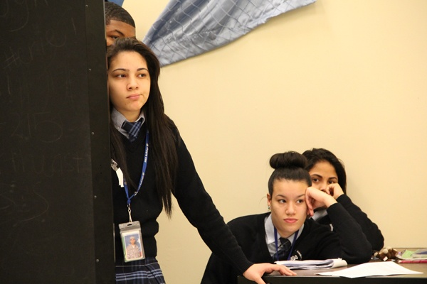 <p>Students Zulydivad Ortiz-Mendez, Natalie Morales and Anneska Maldonado, watch their classmates perform while they wait for their next scene. (Emma Lee/for NewsWorks)</p>