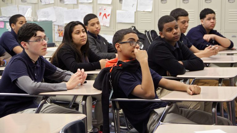 Students attend a sixth-grade class at Julia De Burgos school. The substitute teacher fill rate at De Burgos has improved, but it remains well below the district average. (Emma Lee/WHYY, file)