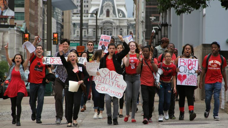 Philadelphia public high school students march down Broad Street from City Hall to school district headquarters during a May 7 budget-cuts protest. (Emma Lee/for NewsWorks)