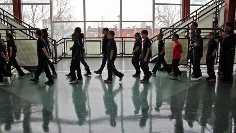 Students walk the halls at De Burgos Elementary School. (Emma Lee/WHYY)
