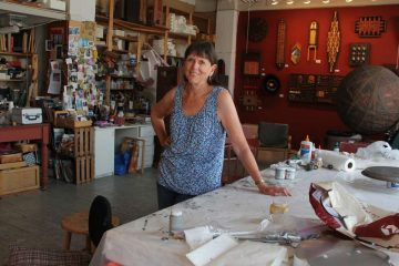 In this 2015 file photo, Carol Cole is comfortably settled into her spacious well-lit studio at 915 Art Building on Spring Garden Street. One of the original artists to occupy the space, she had been there since 1981, and was one of the many artist forced out of the buidling in 2015 due to the fire. (Emma Lee/WHYY)