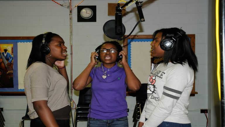 "Three students from Houston School record an original song inside the school's studio, Rural Lane Records, for the CD ""Bully."