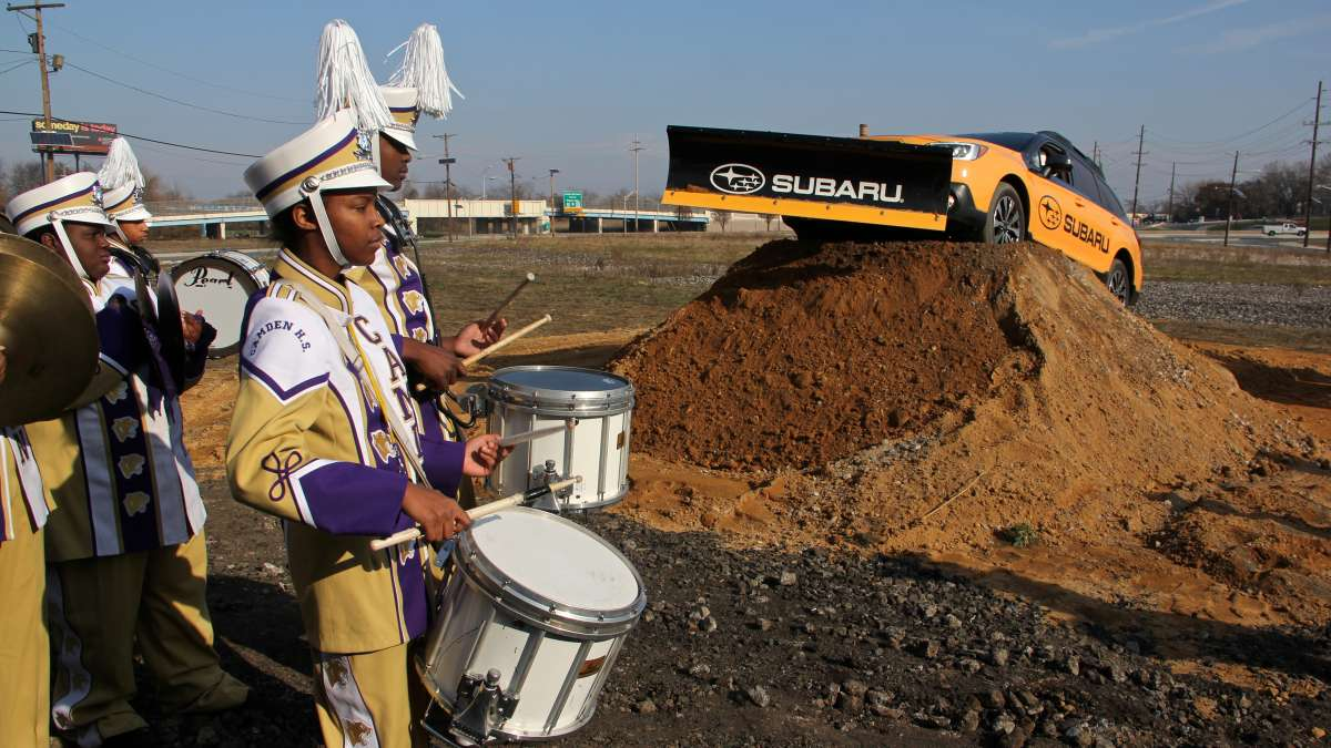 Members of the Camden High School marching band play while Subaru of America ceremoniously breaks ground for its new headquarters.