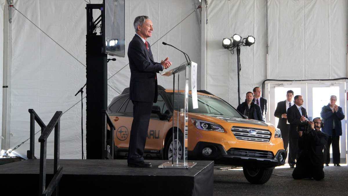 Subaru of America President Thomas Doll applauds his company's move to Camden during a groundbreaking ceremony.