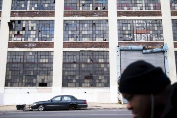 A person walks past a dilapidated building on a spring day in Philadelphia, Pennsylvania.  Aside from Philly, which remains the nation's fifth-largest city, the Commonwealth's biggest residential increases during the past few years occurred in suburban townships. (AP Photo/Matt Rourke)