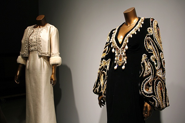 <p>One of the Supremes' most famous dresses is the Black Butterfly, a black velveteen gown featuring voluminous gold brocade bishop sleeves embroidered with gold-work paisleys. (Emma Lee/for NewsWorks)</p>