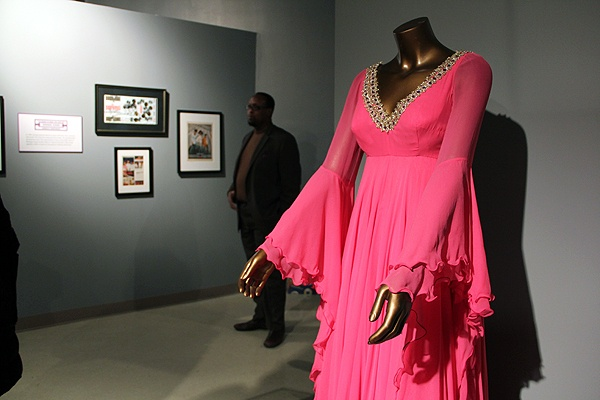 <p>Sullivan's Delight, a hot pink empire dress with bejeweled braided trim, was designed for a segment of the Ed Sullivan Show in 1967. (Emma Lee/for NewsWorks)</p>
