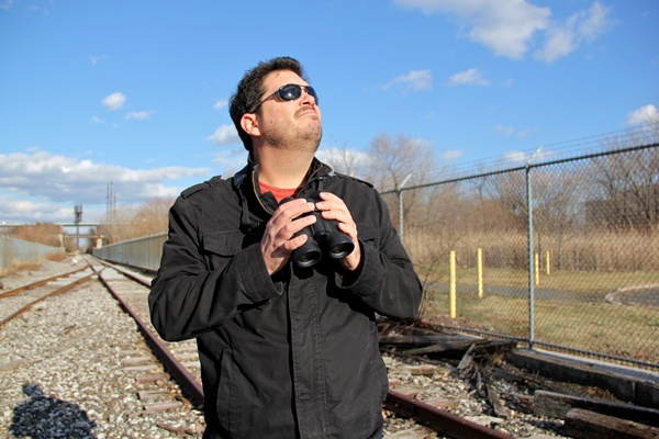 <p>Birder George Armistead uses the railroad tracks that bisect the sewage treatment plant in order to observe the birds that are drawn to it. (Emma Lee/for NewsWorks)</p>