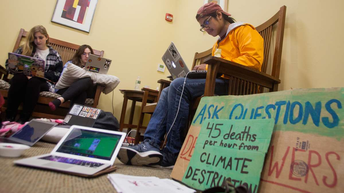 Swarthmore College students gather near the office of the president during day two of a sit-in to call for an end to the college's investment in fossil fuels. (Brad Larrison/WHYY)