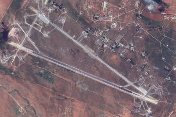 This satellite image provided by DigitalGlobe shows an image captured on April 7 of the Shayrat air base in Syria, following U.S. Tomahawk Land Attack Missile strikes on Friday, April 7, 2017 from the USS Ross (DDG 71) and USS Porter (DDG 78). The United States blasted the air base with a barrage of cruise missiles on Friday, April 7, 2017 in fiery retaliation for this week's gruesome chemical weapons attack against civilians. (DigitalGlobe via AP)