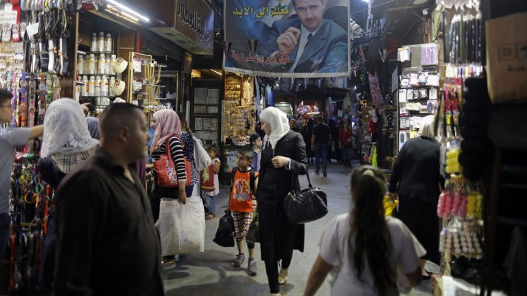 Syrians shop at the Hamadiyah market, or souk in Arabic, that was named after the 34th Sultan of the Ottoman Empire Abdul Hamid II, in the Old City of Damascus in May. (AP Photo/Hassan Ammar, file)