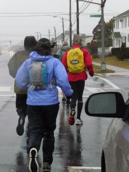 Rain forced runners to sport their rain gear during last year's race. The cold temperatures didn't help either during the run. (Photo courtesy of Steve Antczak)