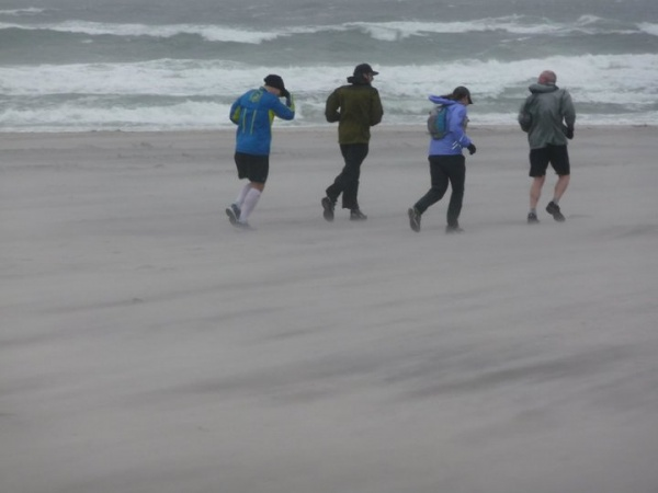 The rain and strong winds continued as runners made their way along the shoreline in full rain gear. (Photo courtesy of Steve Antczak)