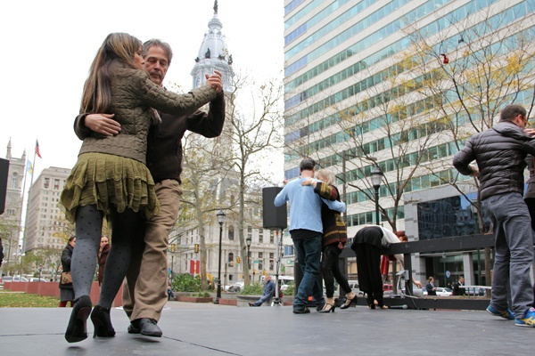<p>Local devotees of Argentine tango take to the stage in Love Park as Argentine Week continues in Philadelphia. (Emma Lee/for NewsWorks)</p>