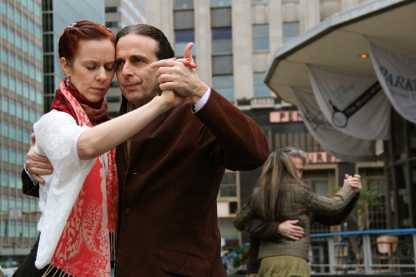 <p>Meredith Klein, director of the Philadelphia Argentine Tango School, dances with Pablo Burstein. About a dozen dancers gathered in Love Park as part of Argentine Week in Philadelphia. (Emma Lee/for NewsWorks)</p>