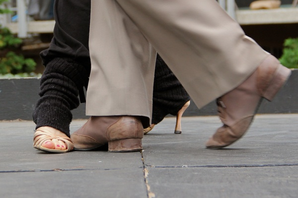 <p>Fancy footwork is on display in Love Park, where about a dozen dancers of Argentine tango demonstrated their skills. (Emma Lee/for NewWorks)</p>