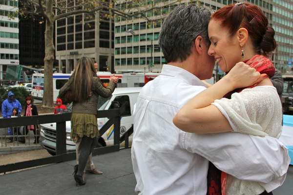 <p>Stephen Macbeth and Meredith Klein tango on the stage at Love Park, demonstrating the Argentine style as part of a celebration of Argentine culture organized by the Embassy of Argentinia. (Emma Lee/fvor NewsWorks)</p>