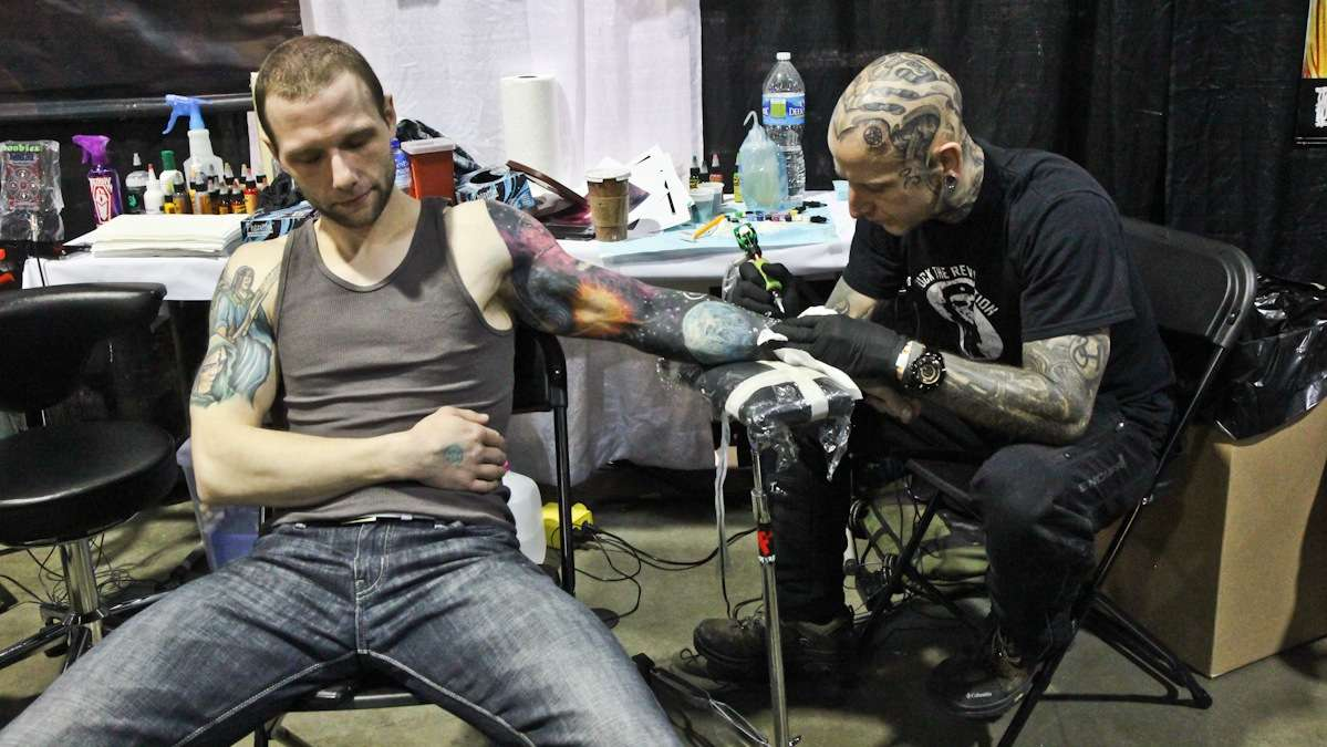Jason Strapec has stars added to his space sleeve by Philadelphia artist Dan Henk. (Kimberly Paynter/WHYY)