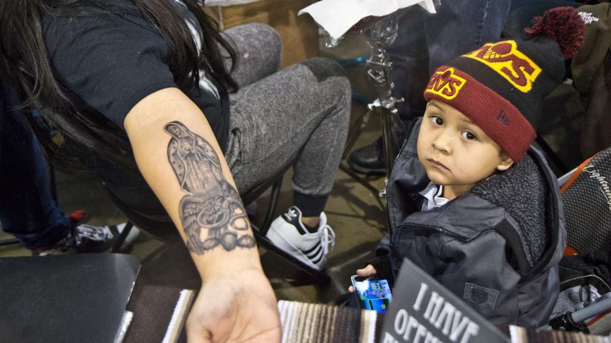 While Marylu Calvario received a tattoo of the Virgin Mary with an eagle to honor her Mexican heritage, her 4-year-old Jonathon kept her company.