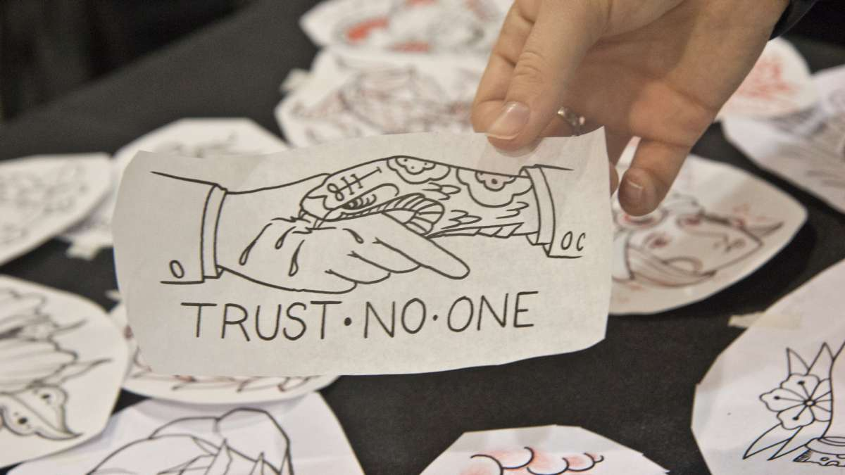 This 'Trust No One' sketch found its way to Justin Cappeletti's leg with the help of tattoo artist Chris Santiago.