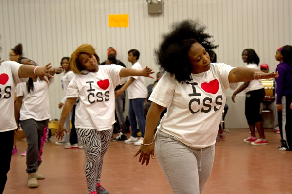 <p><p>Tawanda Jones leads the Camden Sophisticated Sisters step team through a series of warm-up exercises. (Lindsay Lazarski/WHYY)</p></p>