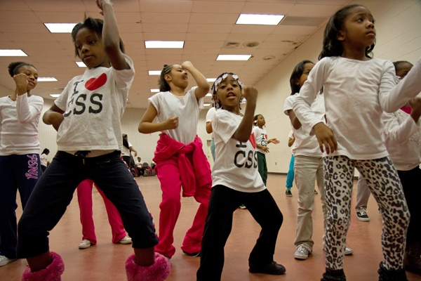 <p>Members of the Camden Sophisticated Sisters practice a routine to the tune of the Elmo theme song for an upcoming performance.  (Lindsay Lazarski/WHYY)</p>