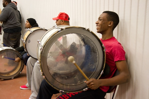 <p>Mateo Jones, 15, keeps busy by  keeping the bass line drum beat for the Camden Sophisticated Sisters about two days a week.  (Lindsay Lazarski/WHYY)</p>