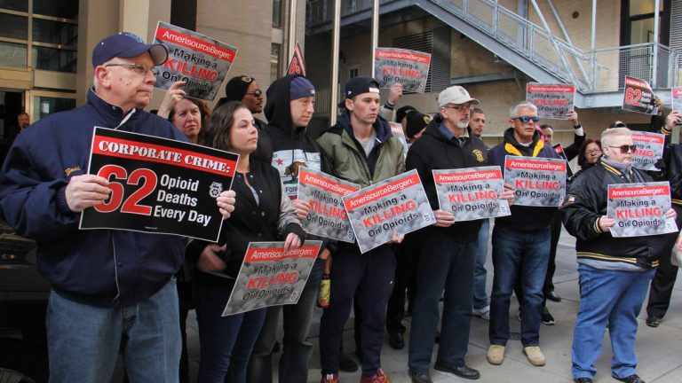 Teamsters concerned about opioid addiction rally outside the Sofitel Hotel in Center City where pharmaceutical company AmerisourceBergen was having its annual shareholders meeting. (Emma Lee/WHYY)