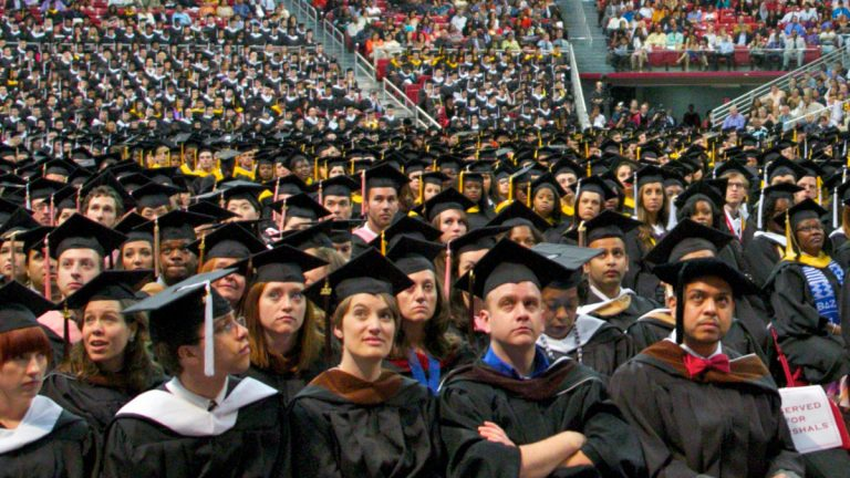 Temple University students are shown at a May 2012 graduation ceremony. Pennsylvania college students graduate owing an average of $36,193.(Nathaniel Hamilton/for WHYY)