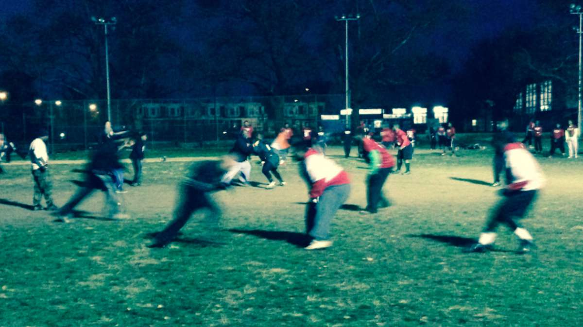 The Imhotep Panthers have a playoff game on the schedule two days after the Thanksgiving 'Legacy Bowl,' but on Thursday, it was a coaches vs. players game at their East Germantown practice field. (Brian Hickey/WHYY)